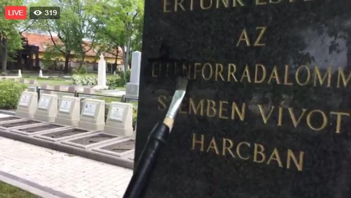Ellenforradalmi emlékművet festett le egy tüntető a Fiumei úti Sírkertben